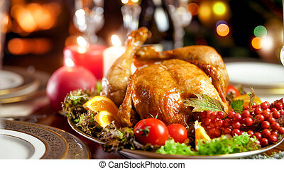 Closeup photo of tasty baked turkey with fresh vegetable on festive family dinner