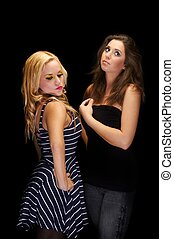 Closeup photo of two young girls in the studio