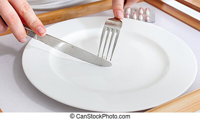 Closeup photo of young woman loosing weight with empty plate