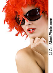 sexy woman with red feather wig and sunglasses