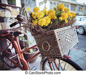 Closeup picture of a vintage bike with flowers in a basket