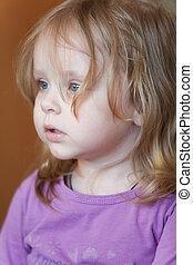 Closeup picture of pensive small Caucasian girl