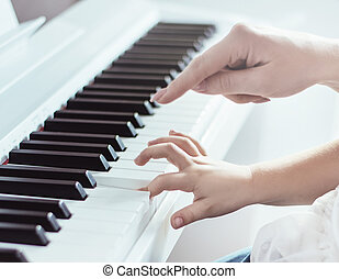 Closeup picture of two hands playing piano