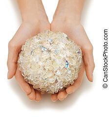 woman hands holding bath ball