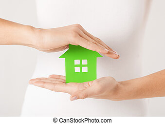 woman hands holding green house - closeup picture of woman ...