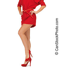 picture of woman in red dress on high heels