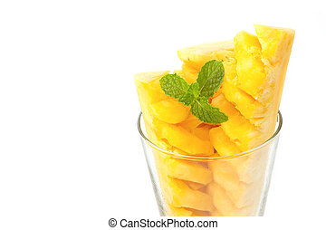 Closeup Pineapple slices in glass with mint leaf on white background