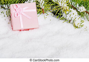 pink christmas present in snow
