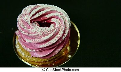 closeup pink zephyr on black background - closeup homemade...