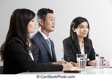 Closeup portrait Chinese Business people having a meeting -...