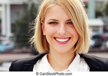 Closeup portrait of a attractive smiling woman