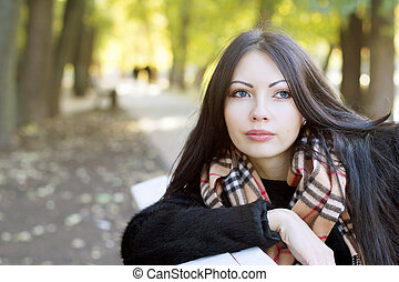 attractive young woman in autumn park