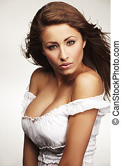 attractive young woman relaxing on white background -...