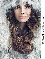 Closeup portrait of a beautiful brunette woman