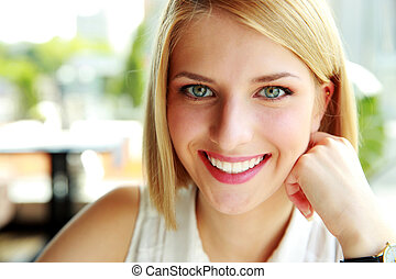Closeup portrait of a beautiful happy woman