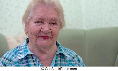 Closeup portrait of a beautiful old woman
