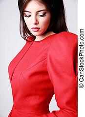 Closeup portrait of a beautiful woman in red dress