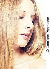 closeup portrait of a beautiful woman looking on side down