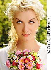 Close=up portrait of a beautiful woman with flowers