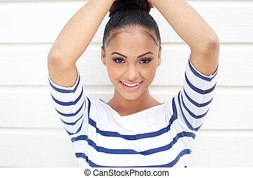 Closeup portrait of a beautiful young latin women smiling