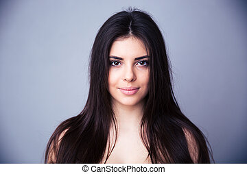 Closeup portrait of a beautiful young woman