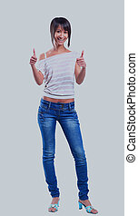Closeup portrait of a beautiful young woman showing thumbs up sign.