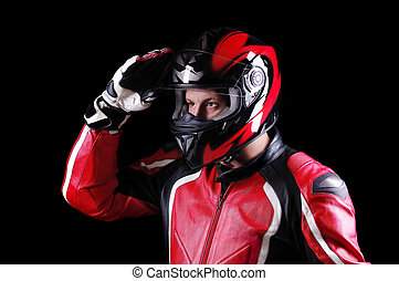 closeup portrait of a biker holding his helmet isolated on black background