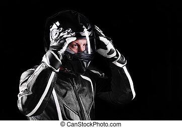 closeup portrait of a biker in black uniform