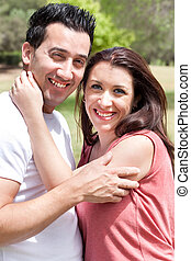 Closeup Portrait Of A Cute Couple Hugging