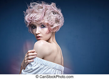 Closeup portrait of a cute girl with a pink hairstyle