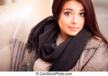 Closeup portrait of a cute young woman at home