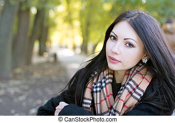 cute young woman in autumn park