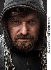 Closeup portrait of a dangerous criminal