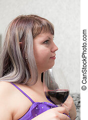 girl with a glass of red wine