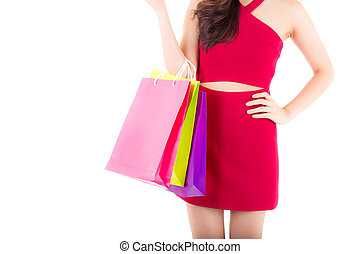 closeup portrait of a happy excited asian woman in red dress standing and holding colorful shopping bags with happy isolated on a white background.
