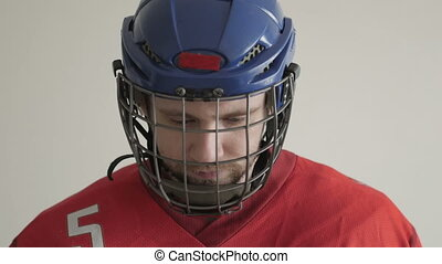 Closeup Portrait of a Hockey Player in Helmet against White Backround