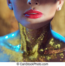 Closeup portrait of a lady with golden neck