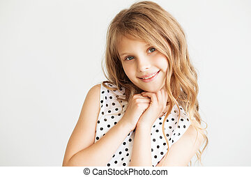 portrait of a lovely little girl against a white background