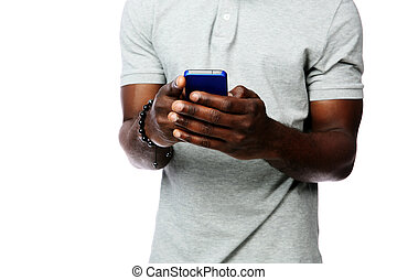Closeup portrait of a male hands using smartphone isolated on white background