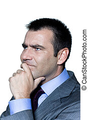 Closeup portrait of a pensive worried businessman in studio on isolated white background
