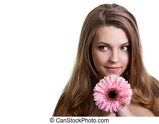 closeup portrait of a pretty young woman holding pink flower
