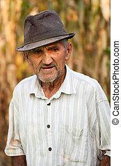 Closeup portrait of a senior man outside