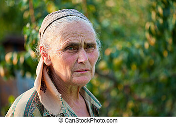 Closeup portrait of a senior woman outside