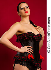 portrait of a sexy young woman in black corset