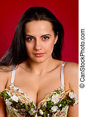 closeup portrait of a sexy young woman in  corset  against red  background