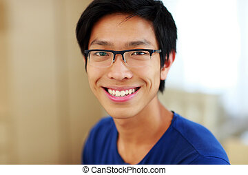 Closeup portrait of a smiling asian man