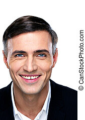 Closeup portrait of a smiling businessman over white background