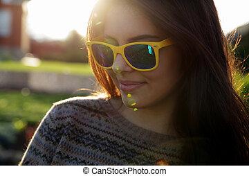 Closeup portrait of a smiling fashionable woman