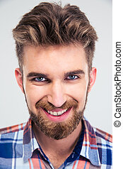 Closeup portrait of a smiling man looking at camera