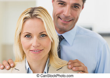Closeup portrait of a smiling woman and man